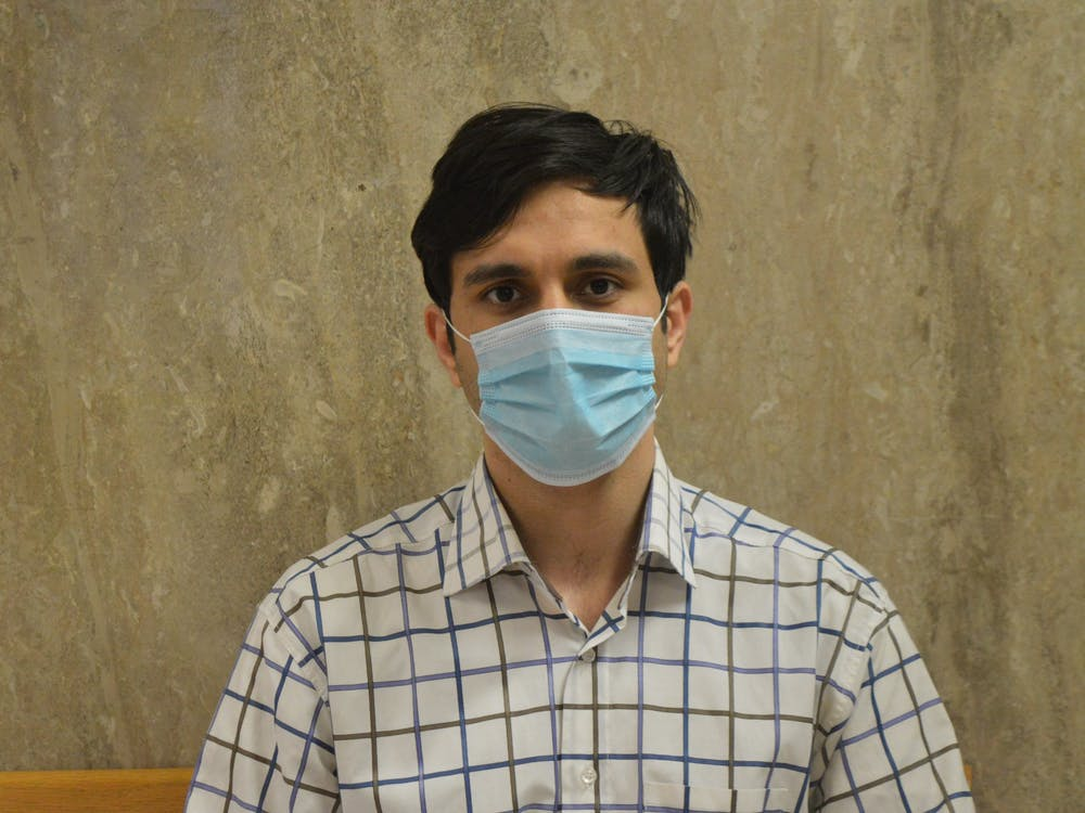 Abolfazl Alipour, 29, poses for a photo with a mask. Alipour is a supporter of the Indiana Graduate Workers Coalition who also joined the 2021 Committee for Fee Review.