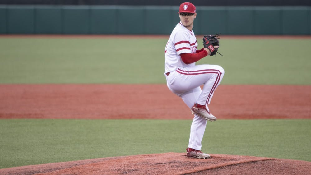 Junior left-hand specialist Andrew Saalfrank prepares to pitch Feb. 27 at Bart Kaufman Field. IU played Butler University and won, 9-3.