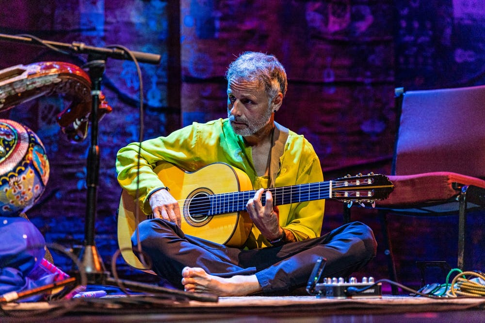 <p>A performer accompanies Saraswathi Ranganathan Sept. 25, 2021, on the stage of the Buskirk-Chumley Theater. The performance was part of the 28th annual Lotus World Music &amp; Arts Festival.</p>