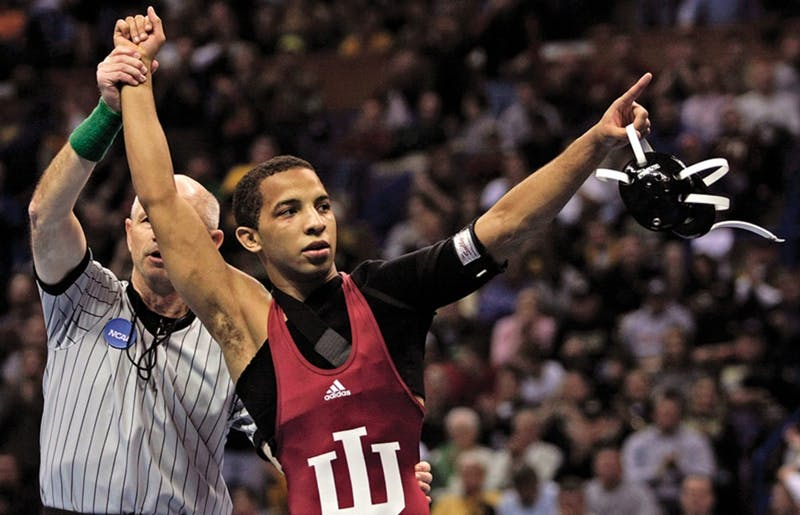 Indiana's Angel Escobedo celebrates his victory over Minnesota's Jayson Ness in a 125 pound championship match at the NCAA wrestling national championships Saturday, March 22, 2008, in St. Louis. Escobedo was recently named the head wrestling coach at IU.