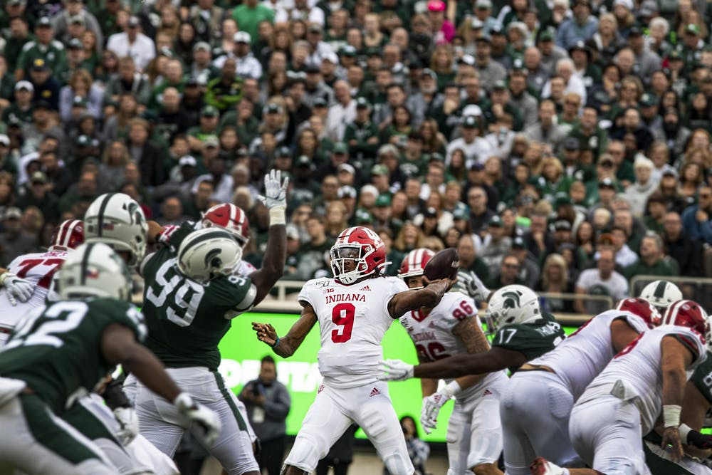 <p>Quarterback Michael Penix Jr. throws the ball Sept. 28, 2019, in Spartan Stadium in East Lansing, Michigan. No. 10 IU plays Michigan State on Saturday for the Old Brass Spittoon trophy.</p>