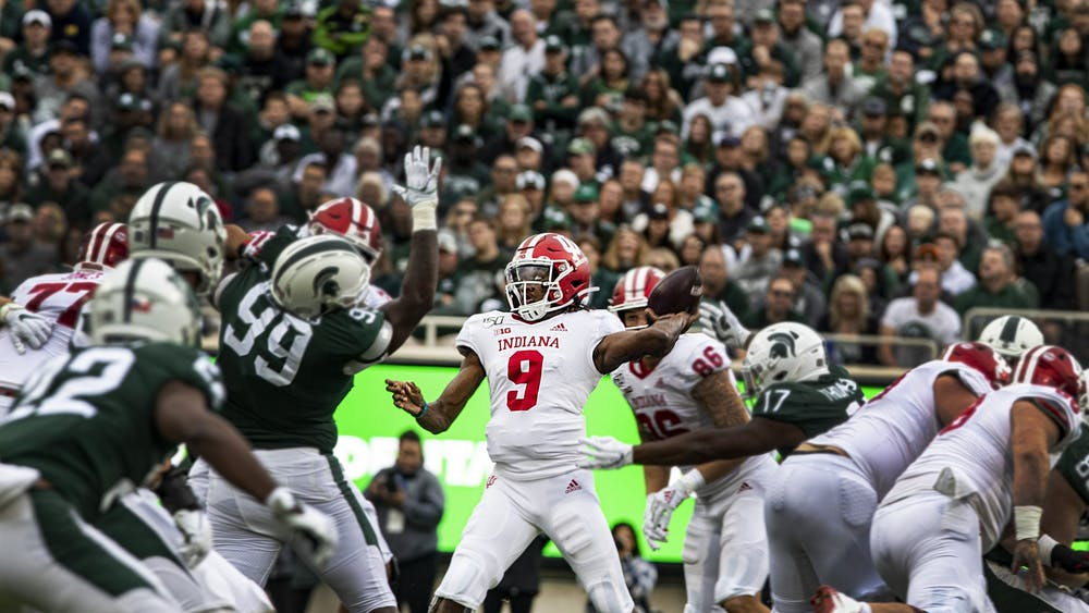 Quarterback Michael Penix Jr. throws the ball Sept. 28, 2019, in Spartan Stadium in East Lansing, Michigan. No. 10 IU plays Michigan State on Saturday for the Old Brass Spittoon trophy.
