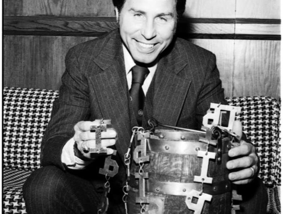 "Former IU head football coach Lee Corso poses with the Old Oaken Bucket in 1976. Now a beloved personality on ESPN's ""College Gameday,"" Corso coached the Hoosiers from 1973-1982, and he won the bucket four times in his 10-year career with IU."