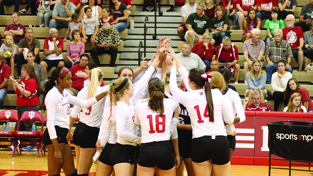 The IU volleyball team cheers before their game against Arkansas State on Sept. 16, 2016 at IU University Gym. The team will open up Big Ten Conference play against Northwestern on Friday.