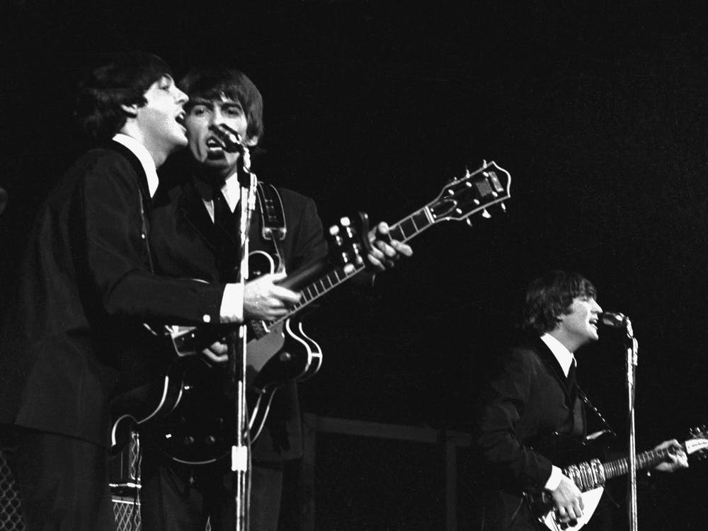 """The Beatles perform at a show in 1964 in the United States. The band released """"Hey Jude"""" in 1968."""
