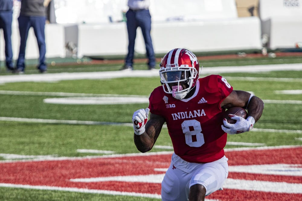 <p>Junior running back Stevie Scott III runs with the ball Oct. 24 in Memorial Stadium. IU head coach Tom Allen announced Monday during a Zoom call that five individuals were named the team's Offensive Player of the Week.</p>