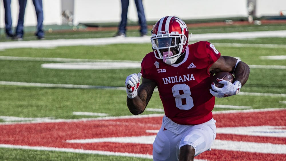 Junior running back Stevie Scott III runs with the ball Oct. 24 in Memorial Stadium. IU head coach Tom Allen announced Monday during a Zoom call that five individuals were named the team's Offensive Player of the Week.