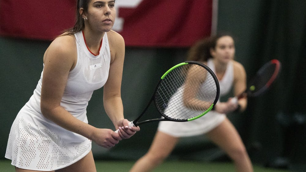 Senior Annabelle Andrinopoulos and junior Jelly Bozovic compete Feb. 2 at the IU Tennis Center in doubles in a match against Xavier University . IU won 4-0.