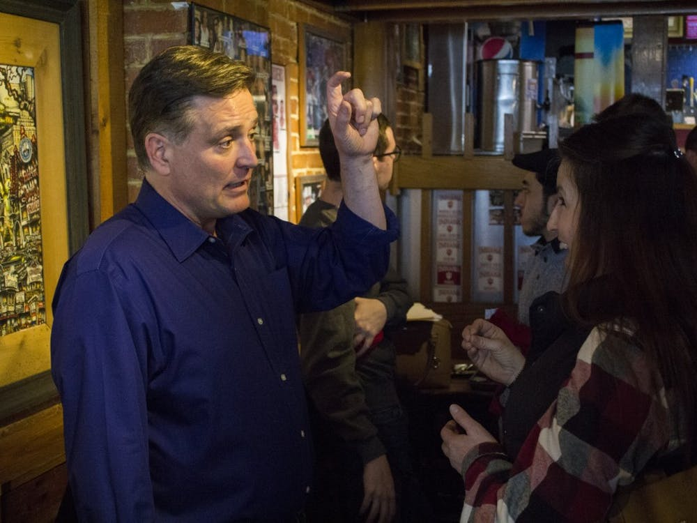 Rep. Luke Messer, R-6th District, talks about his campaign with Bloomington resident Debra Goodwin on Saturday, April 7. Messer was at BuffaLouie's campaigning for the U.S. Senate.