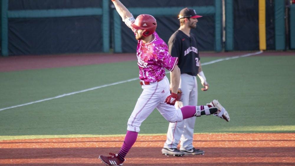 Senior utility Matt Lloyd cheers as he advances to third base April 16 at Bart Kaufman Field. Lloyd cheered after hitting a home run against Ball State University.