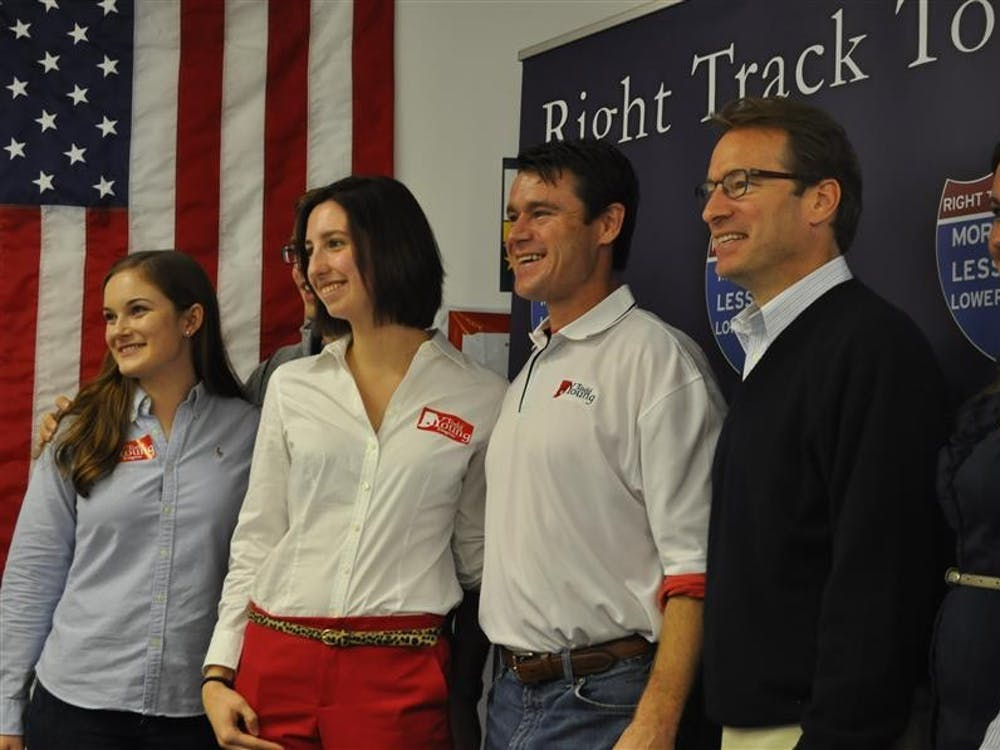 Rep. Todd Young and Rep. House Chief Deputy Whip Peter Roskam meet with members of College Republicans and Young's campaign staff at the Monre County GOP Headquarters Oct. 20, 2012.