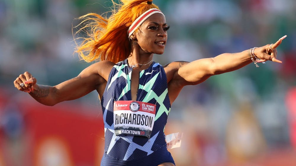 Sha'Carri Richardson runs and celebrates in the Women's 100-meter semifinal on day 2 of the 2020 U.S. Olympic Track & Field Team Trials at Hayward Field on June 19, 2021 in Eugene, Oregon. Richardson will not compete in the 100-meter dash at the Olympics due to a suspension from a positive marijuana test last week.