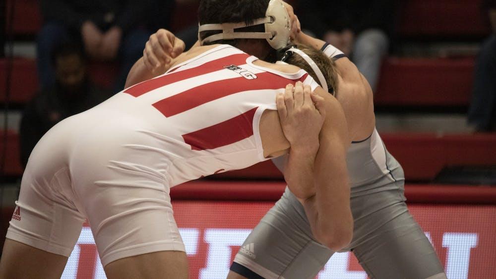 Redshirt freshman Kyle Lugis wrestles University of Tennessee Chattanooga junior Chris Debien on Feb. 24 in Wilkinson Hall. IU wrestling sent competitors to two separate tournaments last weekend.