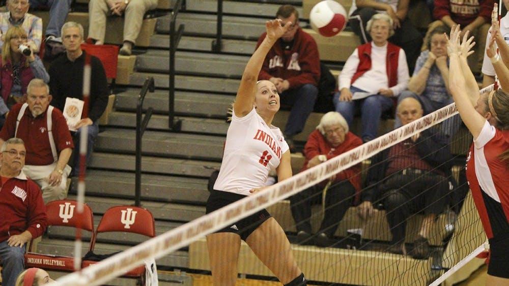 Senior Outside Hitter Allison Hammond tries to spike the ball during the 2015 game against Nebraska at the University Gym.