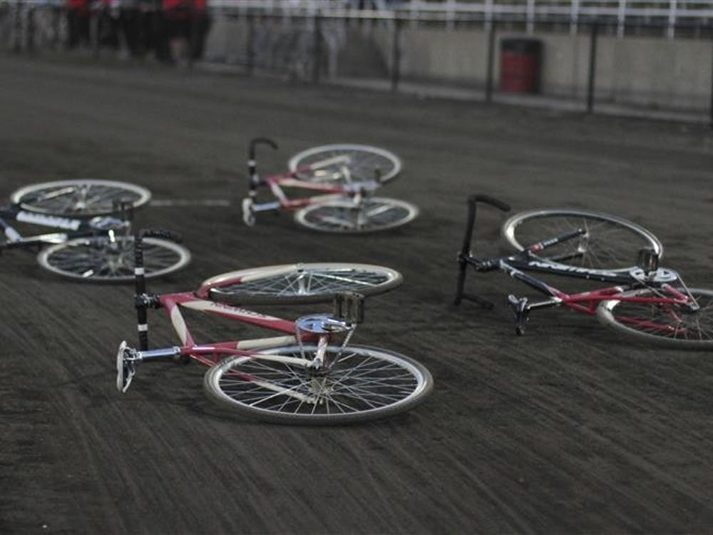 Previous models of Schwinn Little 500 bicycles lie on the track before Delta Gamma begins its run in the finals of Team Pursuit on April 13.