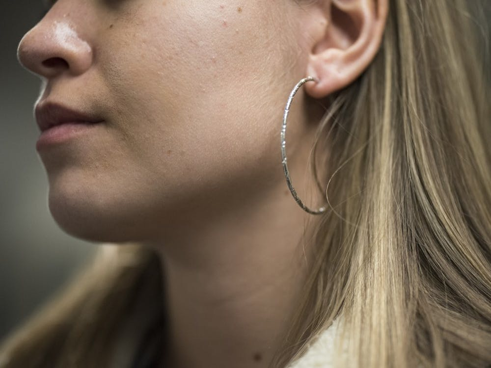 According to columnist Katie Chrisco, hoop earrings are a new Black Friday trend. Other Black Friday trends include embroidered boots and fur jackets.