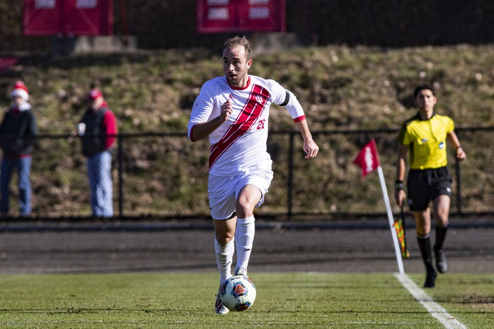 <p>Then-junior midfielder Spencer Glass runs with the ball Nov. 24, 2019, at Bill Armstrong Stadium. Glass was named to the MAC Hermann Award Watch List on Thursday. </p>