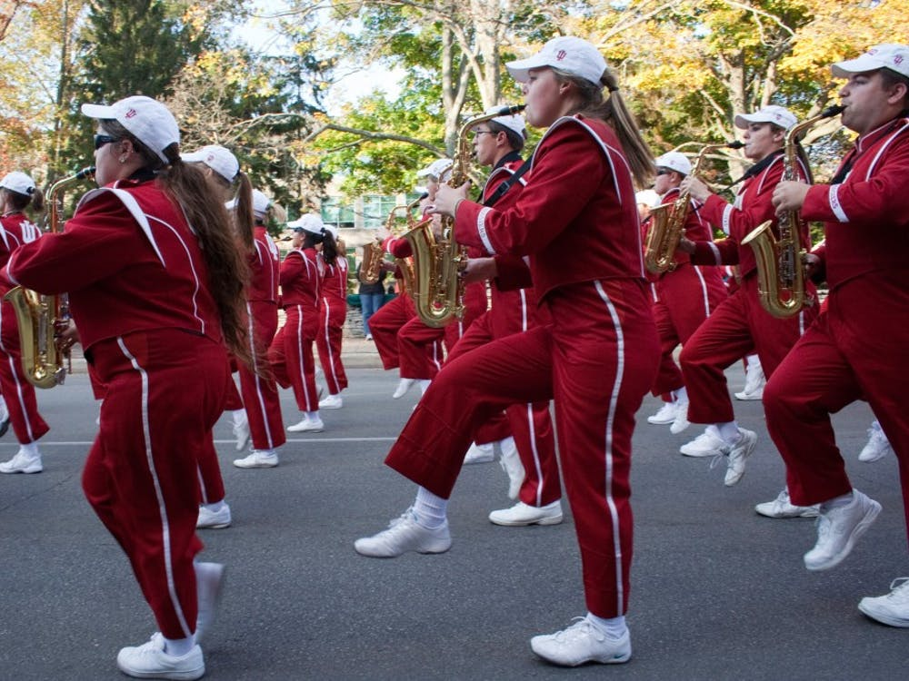 Members of the IU Marching Hundred perform Friday in the annual Homecoming Parade.