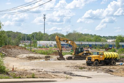 "Construction equipment is parked May 25 at 1730 S. Walnut Street, the area of a new affordable housing project. It was described as a part of Bloomington that is ""in transition"" by City of Bloomington spokesperson Yaël Ksander."