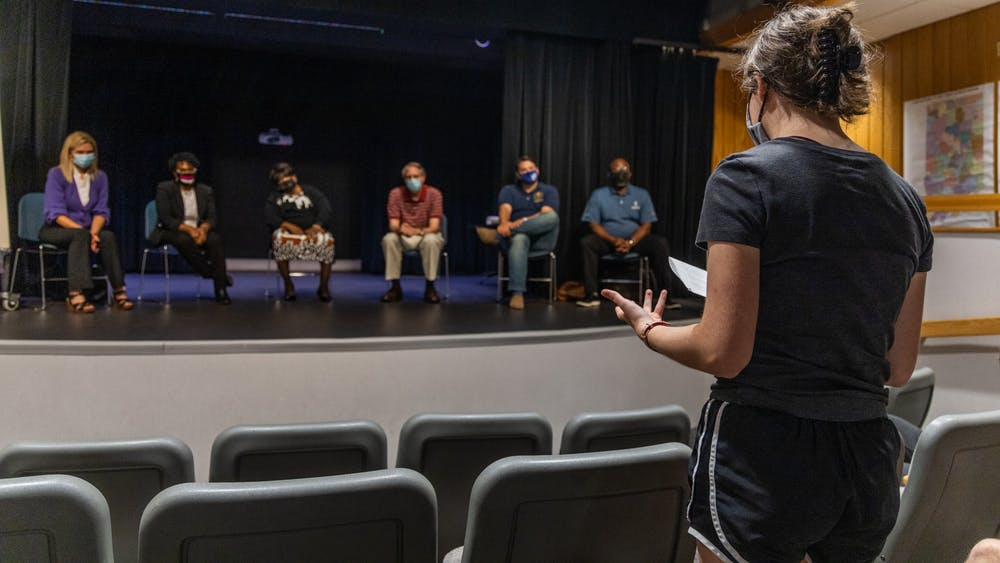 Tilly Robinson, Bloomington South High School senior, asks a question to the members of the Indiana Senate Democratic Caucus's panel Sept. 27, 2021, in the Monroe County Public Library auditorium. The caucus had three public input sessions across the state to discuss the proposed maps.