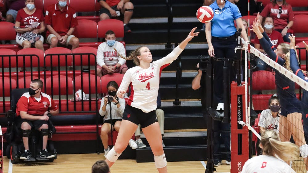 Freshman outside hitter Mady Saris tips the ball Sept. 17, 2021, in Wilkinson Hall. IU lost 0-3 to Ole Miss.