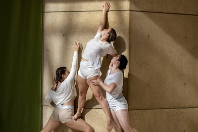 Juniors Savannah Lewis, Carley Liegel and senior Kelsey Smock perform Nov. 8 in the Eskenazi Museum of Art. Ascension is a site-specific piece choreographed to showcase the developments and architectural changes done to the museum.
