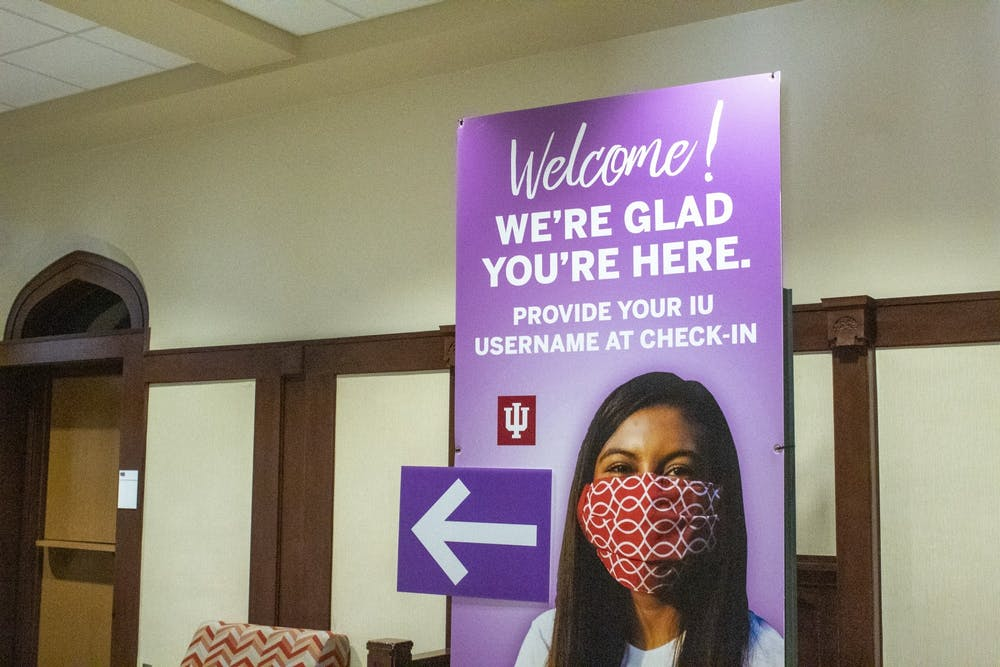 A sign leading to the President's Hall testing center is seen Aug. 29 in the lobby of Franklin Hall.