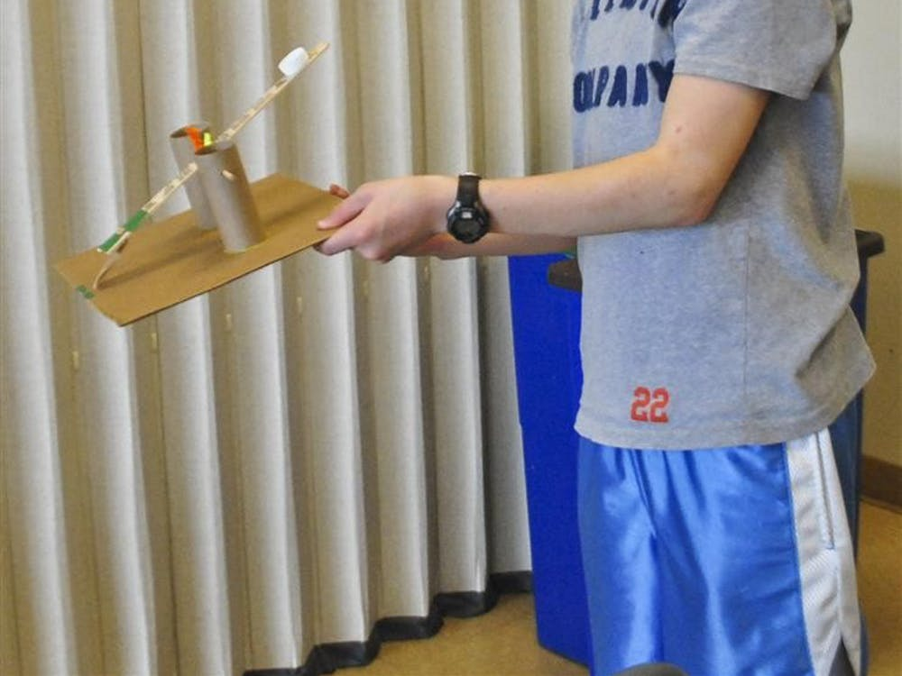 Jake Lowinger, 13, showcases his catapult on Saturday at the WonderLab Museum of Science, Health and Technology. WonderLab put on an exhibition teaching children how to build their own catapults.