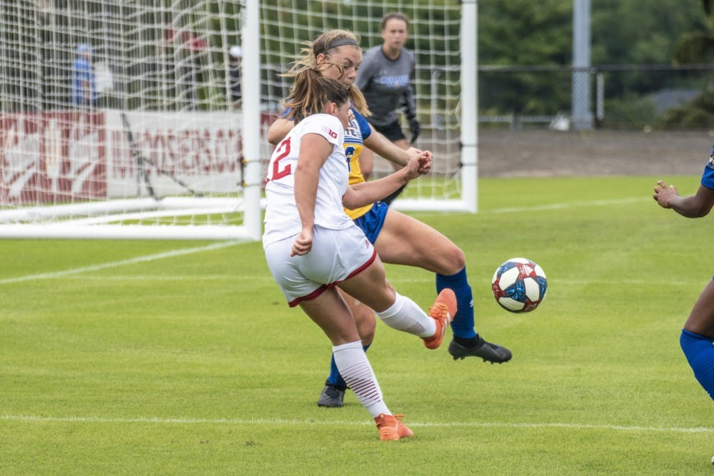 <p>Junior Melanie Forbes plays a ball into the box during IU's match against Morehead State University on Sept. 8 at Bill Armstrong Stadium. IU has outscored opponents 7-1 in the last two matches, most recently recording a 2-1 victory against the University of Tennessee at Martin.</p>