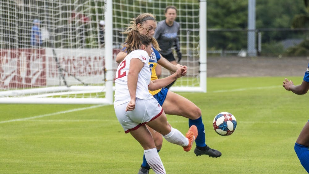 Junior Melanie Forbes plays a ball into the box during IU's match against Morehead State University on Sept. 8 at Bill Armstrong Stadium. IU has outscored opponents 7-1 in the last two matches, most recently recording a 2-1 victory against the University of Tennessee at Martin.