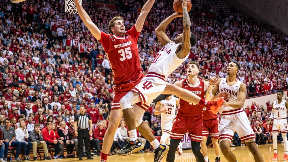 Senior guard Devonte Green gets blocked while shooting March 7 against Wisconsin in Simon Skjodt Assembly Hall. Green was one of the seniors celebrated after the game.
