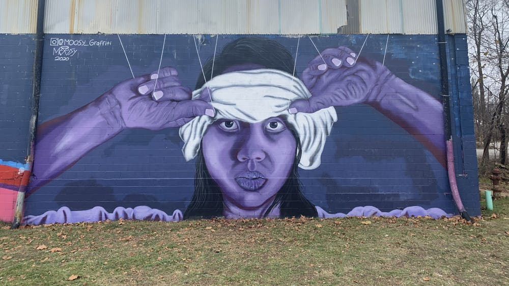 Sophomore Trenton Musch's mural is pictured Nov. 20 at the Warehouse. The face in the mural is based off of Shun Lin, his neighbor and friend.