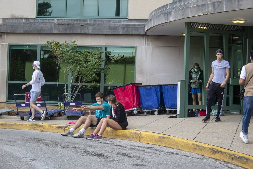 <p>Students sit outside Aug. 18 in front of Eigenmann Hall. Upon arrival for move in all students underwent a symptom check and COVID-19 test, with no more than 1,500 students moving to campus per day. </p>