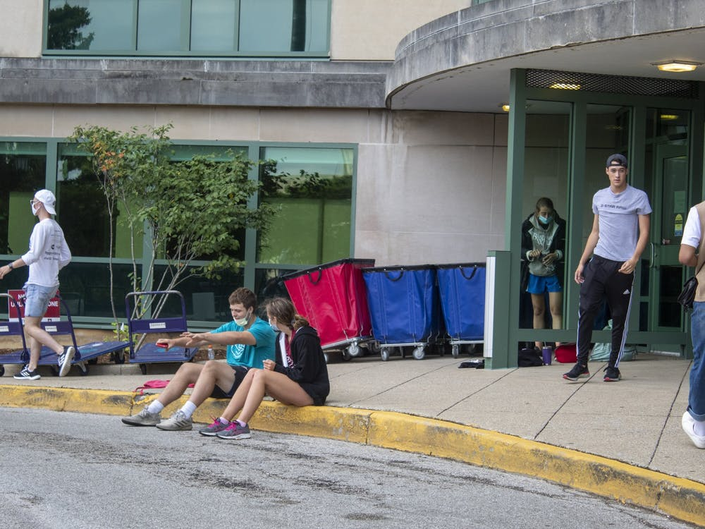 Students sit outside Aug. 18 in front of Eigenmann Hall. Upon arrival for move in all students underwent a symptom check and COVID-19 test, with no more than 1,500 students moving to campus per day.