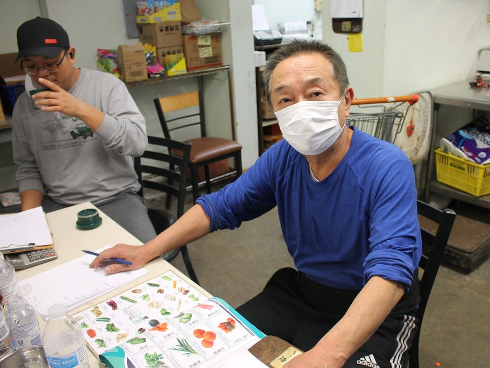 Mark Li, owner of B-Town International Market, works in his store on Tuesday evening. Bloomington's Asian business owners have faced challenges growing their businesses and maintaining their sales levels during the COVID-19 pandemic.