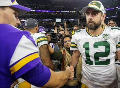 Minnesota Vikings quarterback Kirk Cousins and Green Bay Packers quarterback Aaron Rodgers greet each other at the end of their game Nov. 25, 2018, at U.S. Bank Stadium in Minneapolis.