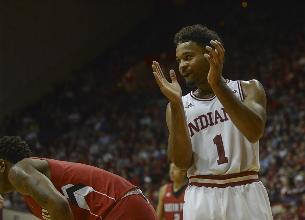 "Sophomore guard James Blackmon Jr. claps after Kevin ""Yogi"" Ferrell dove for the ball during the game against Austin Peay on Monday at Assembly Hall. The Hoosiers defeated the Governors 102-76."