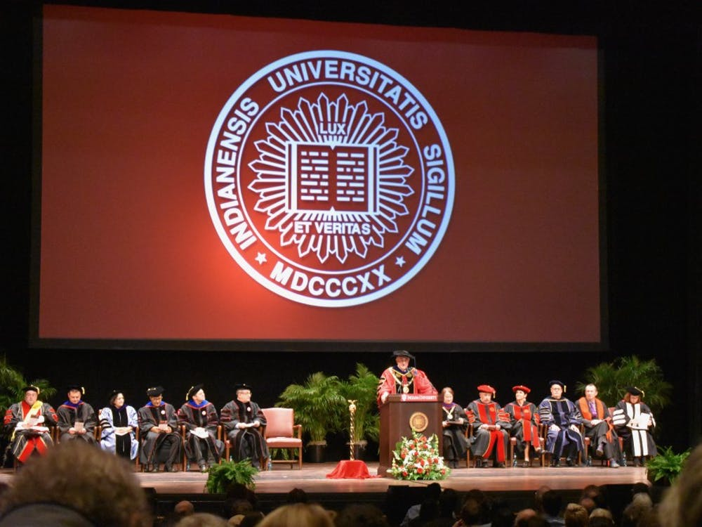 IU President Michael McRobbie introduces Salman Rushdie before presenting him with an honorary degree Thursday. Rushdie gave a speech on fiction after the ceremony.