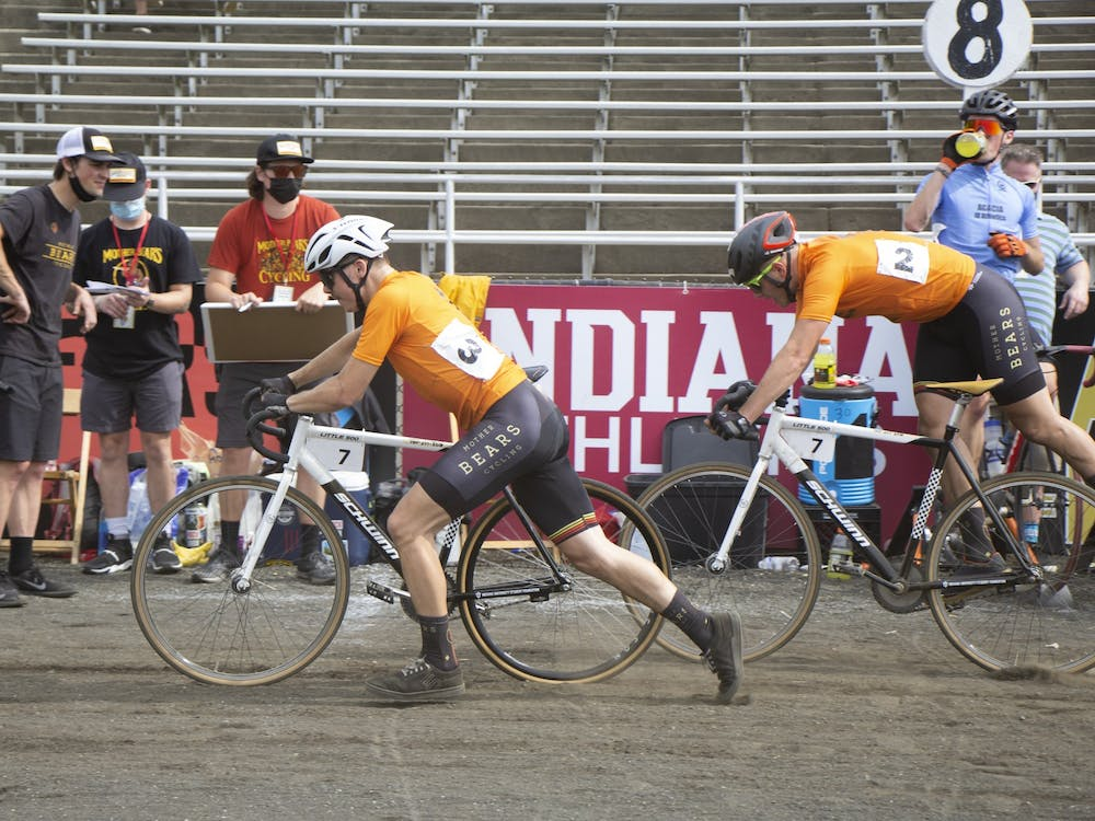 Sophomore Cooper Young jumps swaps places with sophomore Vince Obermeyer during the 2021 Little 500 on May 26.