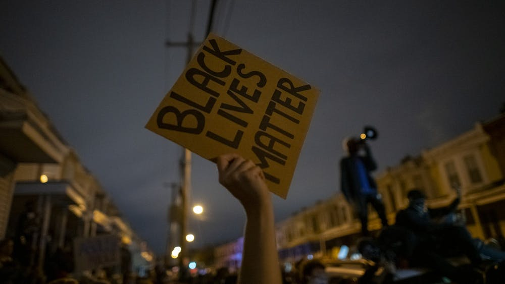 "A protestor holds a sign that reads ""Black Lives Matter"" Oct. 27, 2020, in Philadelphia."