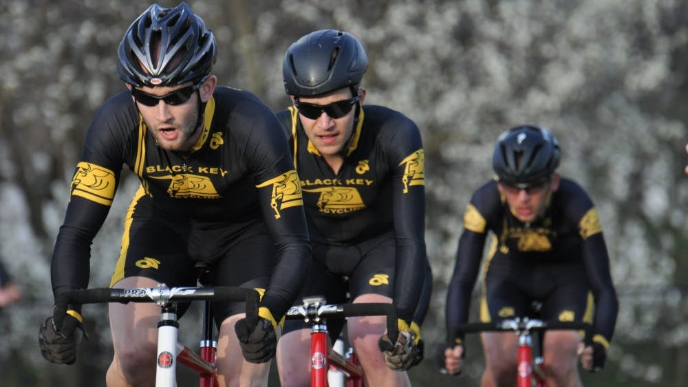 Cyclists from Black Key Bulls ride during the Team Pursuit event on Sunday at Bill Armstrong Stadium. Black Key Bulls finished first in the event.