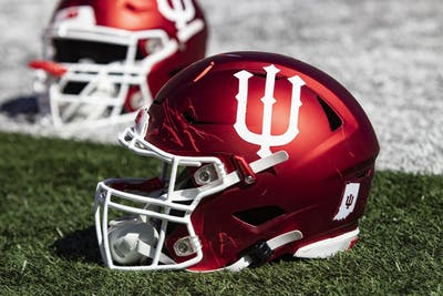 An IU football helmet sits on the field Oct. 12 in Memorial Stadium. IU played Rutgers during Homecoming weekend.