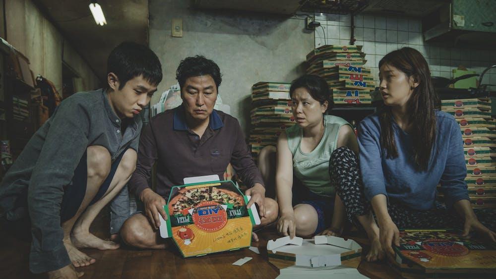 """Kim Ki-woo (Choi Woo-sik), Kim Ki-taek (Song Kang-Ho), Kim Chung-sook (Chang Hyae-Jin) and Kim Ki-jung (Park So-Dam) perform in the 2019 movie """"Parasite."""""""