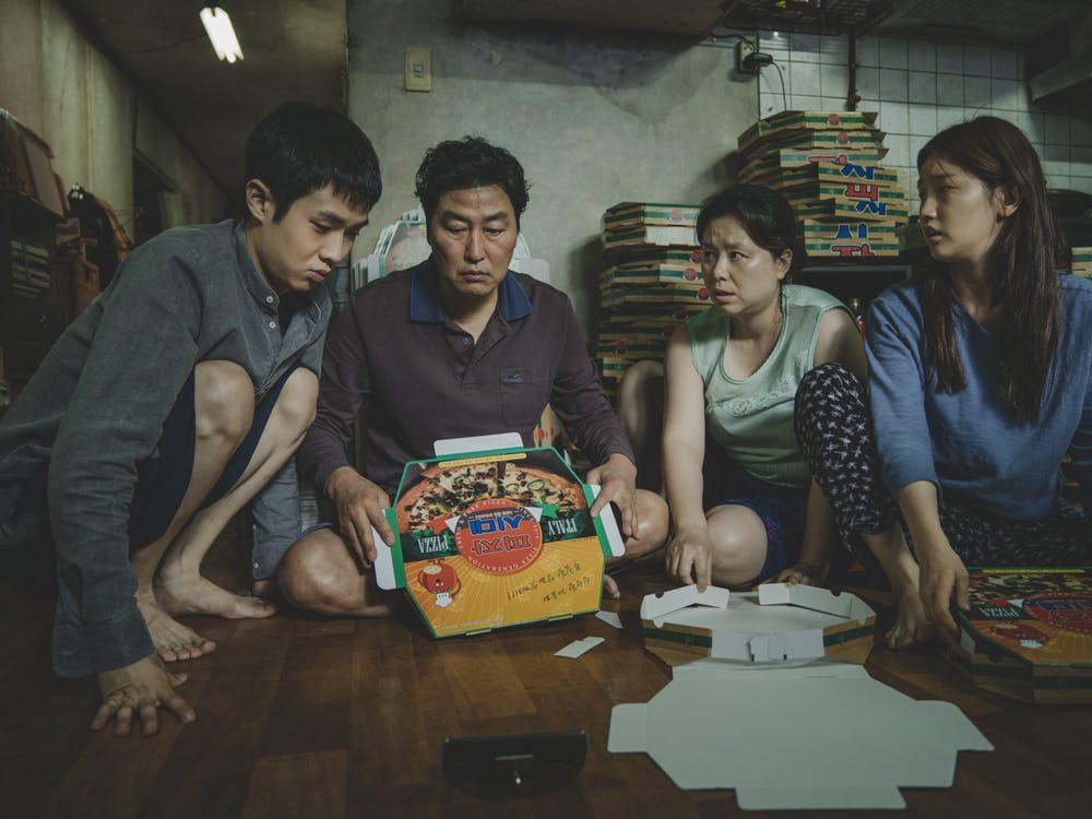 "Kim Ki-woo (Choi Woo-sik), Kim Ki-taek (Song Kang-Ho), Kim Chung-sook (Chang Hyae-Jin) and Kim Ki-jung (Park So-Dam) perform in the 2019 movie ""Parasite."""