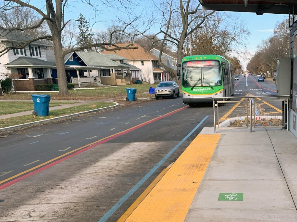 <p>An IndyGo Red Line bus arrives at 54th Street and College Avenue. The Indiana State Senate voted Feb. 27 on an amendment that would cut IndyGo funding if it cannot raise money from private funds.</p>