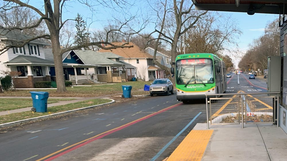 An IndyGo Red Line bus arrives at 54th Street and College Avenue. The Indiana State Senate voted Feb. 27 on an amendment that would cut IndyGo funding if it cannot raise money from private funds.