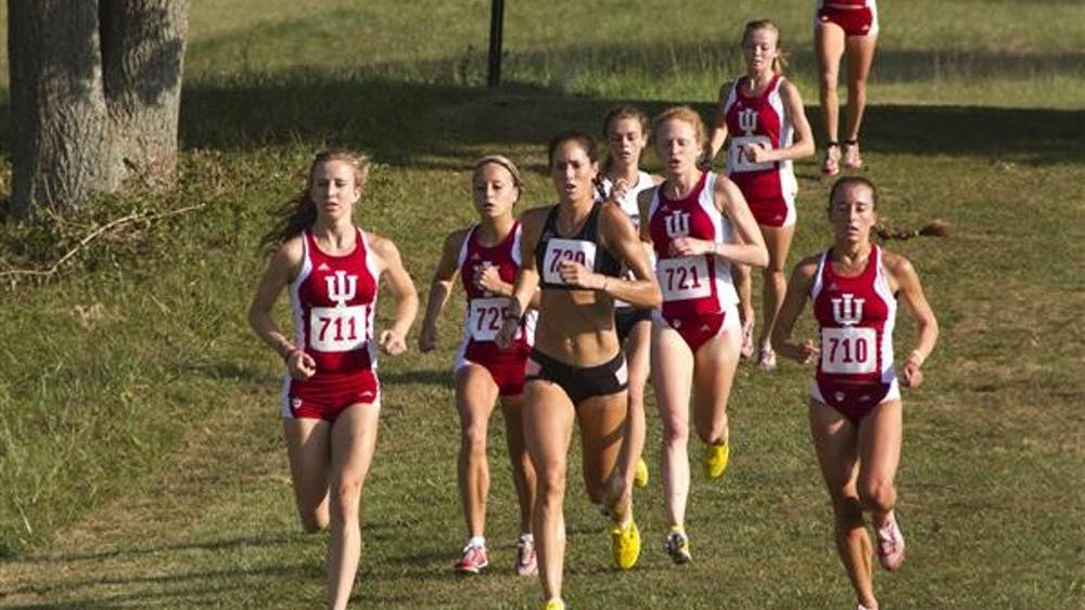 The front pack of the women's race runs toward the 4-kilometer marker in the 5-kilometer race during the IU Open on Saturday morning at IU Cross Country Course.