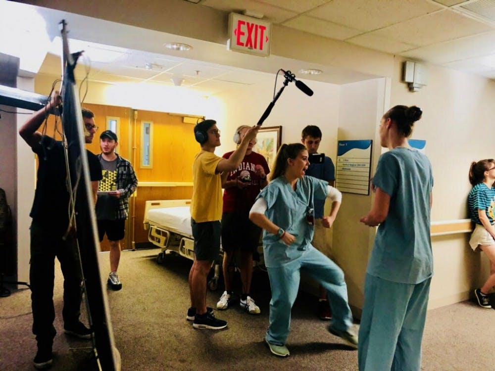 """The cast and crew in the process of filming a scene for senior Dakota Taylor's film """"Anodyne."""" The film was named one of 10 semifinalists in the Producer's Guild of America's Make Your Mark competition."""