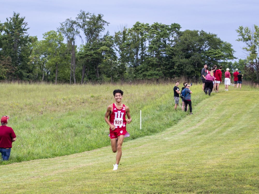 Sophomore Gabriel Sanchez leads in the final stretch of the 8K Sept. 4, 2021, on the IU Championship Course in Bloomington.
