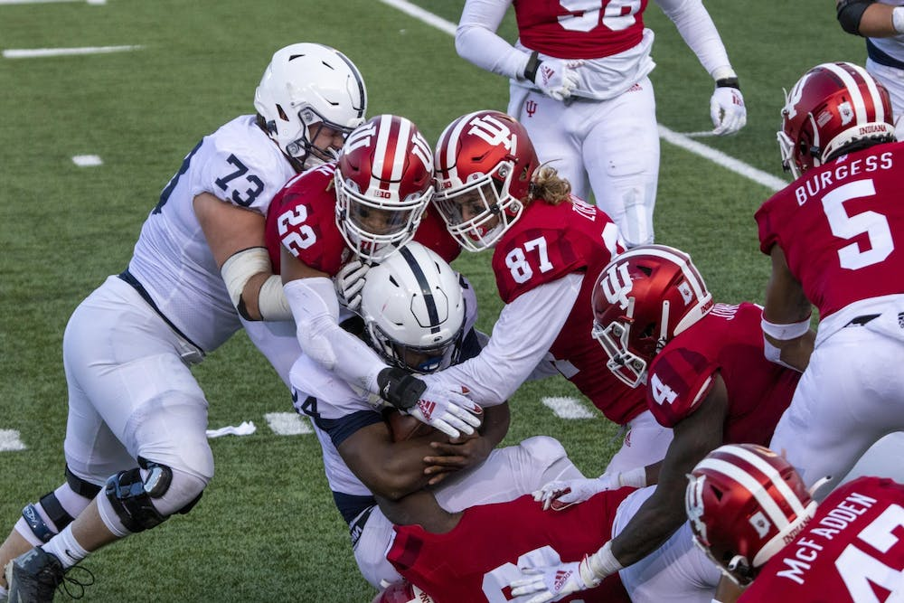 <p>Senior defensive lineman Michael Ziemba and junior defensive back Jamar Johnson tackle Penn State freshman running back Keyvone Lee on Oct. 24 in Memorial Stadium. IU football has paused all team-related activities due to an increase in COVID-19 cases, according to a press release.</p>
